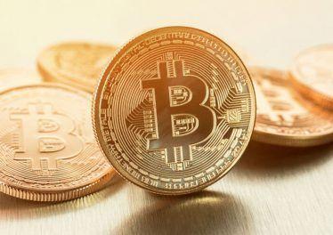 Golden Bitcoins - the new virtual money. Photo