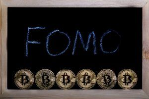 A bitcoin concept as people get fomo, Fear of Missing Out