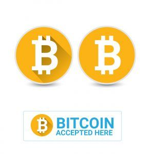 symbol of bitcoin and the sign that says bitcoin is accepted