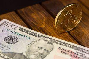 bitcoin and dollar banknote