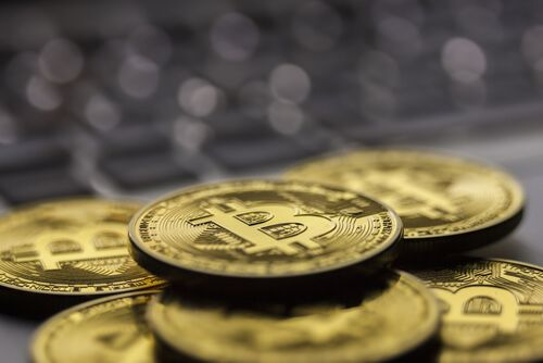 Golden Bitcoins on a gray background