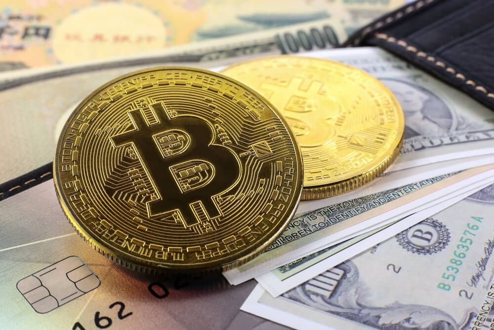Golden bitcoin with wallet and banknote background.