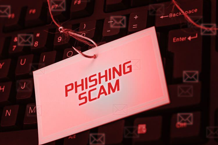 phishing scam on a hook top of a keyboard
