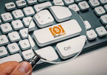 computer key with bitcoin cash logo