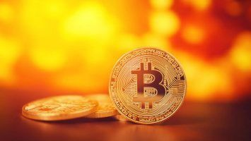 Bitcoin on Golden background