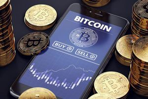 Smartphone with Bitcoin chart on-screen
