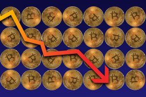 bitcoins with arrow pointing down explaining share prices fall