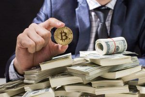 Holding Bitcoin Isolated on black background