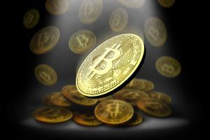 Abstract golden bitcoins price drop.3d rendering.bitcoin symbol backgrounds.