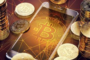 Smartphone with Bitcoin on-screen among piles of Bitcoins. Bitcoin in danger concept. 3D rendering