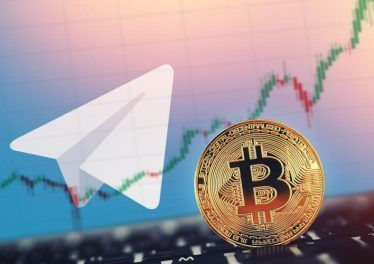 Gold Bitcoin on background of shares coins telegram.