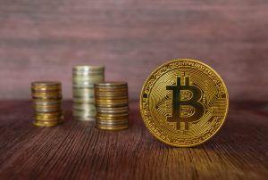 Golden bitcoin on edge.