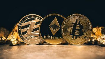 Golden cryptocurrencys Bitcoin, Ethereum, Litecoin and mound of gold - Business concept image