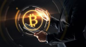 Businessman looking at Bitcoin logo.
