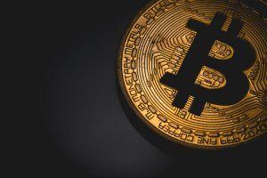 bitcoin logo in the dark