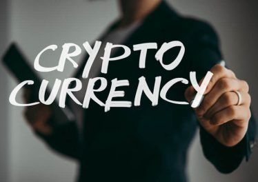 man holds pen or marker and writing Cryptocurrency word