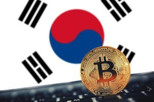 Gold Bitcoin on South Korea flag background
