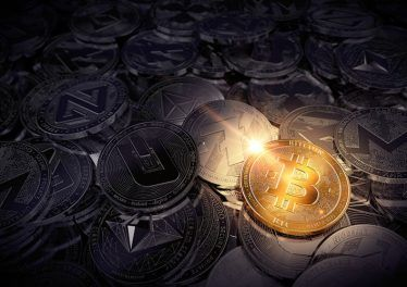 huge stack of physical cryptocurrencies with Bitcoin on the front as the leader of new virtual money. 3D rendering