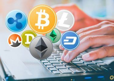 Set of Cryptocurrency and female hands typing on laptop. Business concept of worldwide cryptocurrency.