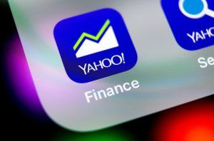 Yahoo finance application icon on Apple iPhone X smartphone screen close-up. Yahoo finance app icon. Social network. Social media icon