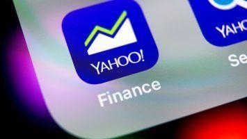 Yahoo finance application icon on Apple iPhone X smartphone screen close-up. Yahoo finance app icon. Social network. Social media icon
