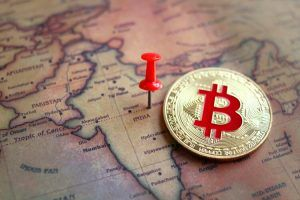 Bitcoin in India part of world map. Investment in/ mining of bitcoin in India concept.
