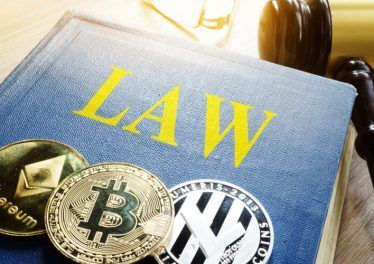 Crypto regulation. Cryptocurrency coins and book Law.