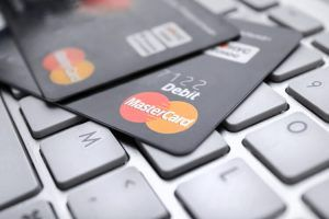 MasterCard credit cards on keyboard