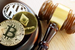 Judge's gavel and cryptocurrency.