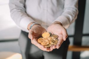 Gold coins and bitcoin on the hands of men .Successful businessmen holding virtual money. Financial investment concept, Crypto currency