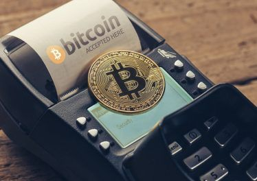Customer pays by bitcoin to pay a bill at the cafe (bitcoin accepted here)