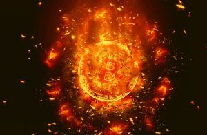 Orange Bitcoin in flames on a balck background.