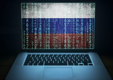 Russian hacker. Hacking laptop with binary computer code and russia flag on the screen. Internet and network security.