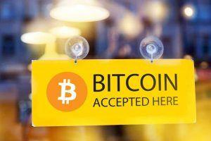 Bitcoins accepted here - logo of bitcoin on restaurant glass door (1)