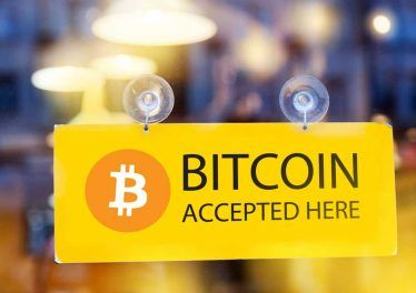 Bitcoins accepted here - logo of bitcoin on restaurant glass door (1)
