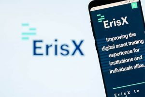 An image featuring a phone that has opened the ErisX application with ErisX logo next to the phone