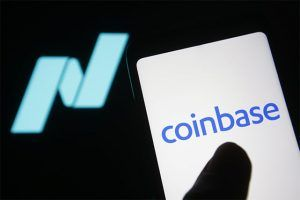 An image featuring a person using the Coinbase platform on their phone