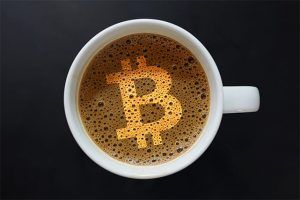 An image featuring a coffee that has the bitcoin logo on it representing crypto hot wallet concept