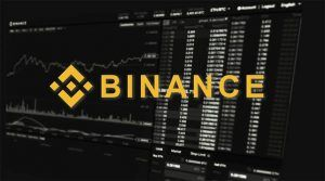 An image featuring the Binance logo with crypto statistics in the background